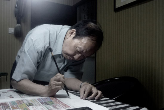 Don Wong working at studio